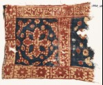 Textile fragment with square, a flower, stars, and Arabic inscription (EA1990.1015)