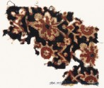 Textile fragment with vine leaves, flowers, and tendrils (EA1990.1019)