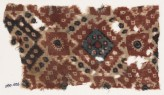 Textile fragment probably imitating patola pattern, with diamond-shapes and squares (EA1990.1026)
