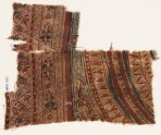 Textile fragment with concentric circles, triangles, and dots (EA1990.1051)