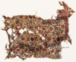 Textile fragment with flowers, leaves, and stars (EA1990.1068)