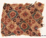 Textile fragment with interlocking quatrefoils, stars, and flowers (EA1990.1098)