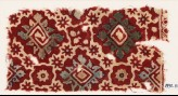 Textile fragment with ornate squares, stars, and flowers (EA1990.1165)