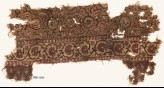 Textile fragment with flower-heads, tendrils, and vine (EA1990.1172)