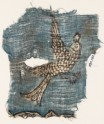 Textile fragment with flying bird