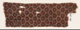 Textile fragment with grid of oval shapes and rosettes (EA1990.1187)