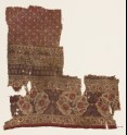 Textile fragment with flower bushes