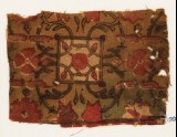 Textile fragment with flowers, squares, and interlace