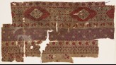 Textile fragment with bands of carnations, grapes, and flower-heads (EA1990.1235)