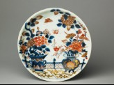 Saucer with flowers on a terrace