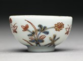 Miniature cup with flowers and butterflies