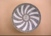 Plate with radial floral decoration and inscription