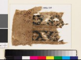 Textile fragment with bands of palmettes and leaves (EA1993.126)