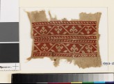 Textile fragment from a belt or scarf with trefoils and leaves (EA1993.154)