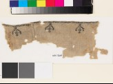 Textile fragment from a garment with stylized birds, trees, and pseudo-kufic inscription (EA1993.180)