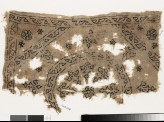 Textile fragment with remains of a roundel, octagon, square, and plant shapes (EA1993.228)