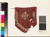 Textile fragment from a tab with a cross, shield-shape, and linked crosses (EA1993.241)