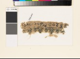 Textile fragment with floral scrolling border, birds, and circles (EA1993.249)