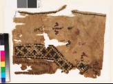 Textile fragment from the neck of a tunic with a V-shape, birds, and plants (EA1993.332)