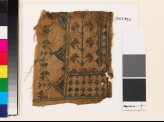 Textile fragment with stylized flowers, diamond-shapes, and triangles
