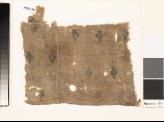 Textile fragment with diamond-shapes and palmettes, probably from a tunic (EA1993.49)