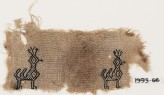 Textile fragment with two peacocks