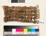 Textile fragment with linked diamond-shapes and palmettes, probably from a belt (EA1993.78)