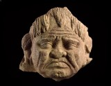 Head of a grimacing yaksha, or nature spirit