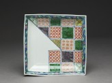 Plate with geometric decoration in the style of textile patterns (EA1995.85)