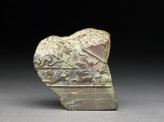 Fragment of a jeweller's mould with animals and birds in relief (EA1996.74)