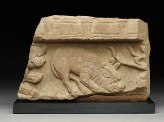 Fragment of a coping stone with horned mythical creature