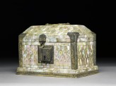 Casket with sloping lid