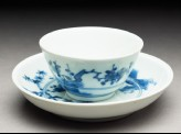 Cup and saucer with leaping tigers