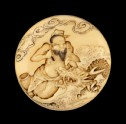 Manjū netsuke depicting the Daoist immortal Bashikō performing acupuncture on a dragon (EA2001.104)