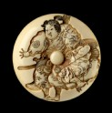 Manjū netsuke depicting Minamoto Yoshitsune practising martial arts with a tengu demon