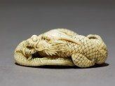 Netsuke in the form of a dragon coiled around a bowl