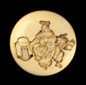 Manjū netsuke depicting manzai dancers at New Year