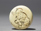 Manjū netsuke with a boy playing with a spinning top