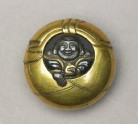 Manjū netsuke depicting Hotei peering from his sack