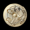 Manjū netsuke depicting Tadanobu defending himself with a gō board