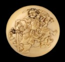 Manjū netsuke depicting Shōki the Demon Queller with two demons (EA2001.90)