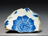 Base fragment of a bowl with flower