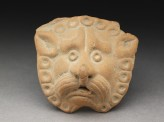 Lion mask from a vase