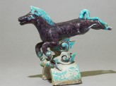 Roof tile in the form of a horse