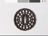 Tsuba in the form of a chrysanthemum