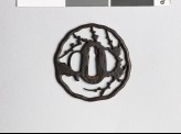 Tsuba with blossoming plum branches (EAX.10311)