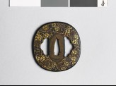 Tsuba with mitsudomoye, or three-comma shapes