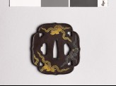 Aoi-shaped tsuba with kiri, or paulownia, leaves