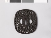 Tsuba with heraldic device and karakusa, or scrolling plant pattern (EAX.10392)