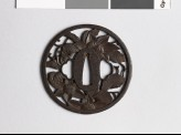 Round tsuba with clematis vine